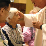 At 90, she joins her late husband in baptism